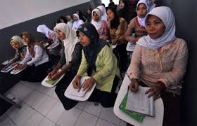 With paper in hand, Indonesian maids fight exploitation