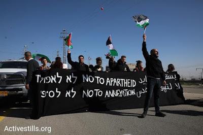 'No to Apartheid': Palestinian activists blockade entrance to Israel's new 'Apartheid Road'