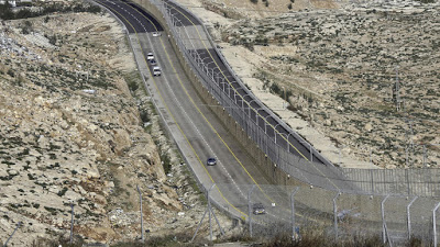 Israel's new 'Apartheid Road' separates Palestinian and Israeli drivers with 8-meter wall