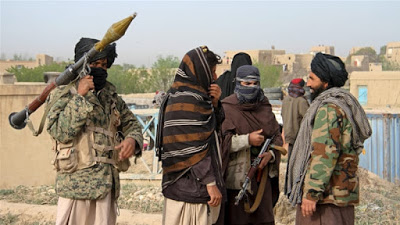 Taliban kills dozens of Afghan forces as peace efforts continue