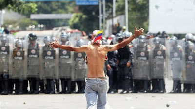 Venezuelans vow to carry on protests as clashes turn deadly