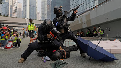 Hong Kong on edge for China anniversary after weekend of chaos