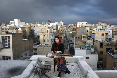 AP PHOTOS: In Iran, isolated musicians perform from rooftops